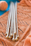 Many wooden spokes lie on an  knitted plaid Stock Photography