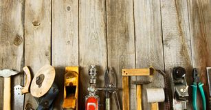 Many working tools on a wooden background. Old working tools. Many working tools on a wooden background Royalty Free Stock Image