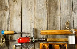 Many working tools on a wooden background Royalty Free Stock Photos