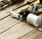 Many working tools on a wooden background Stock Photos