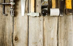 Many working tools on a wooden background. Old working tools. Many working tools on a wooden background Stock Image
