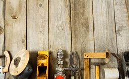 Many working tools on a wooden background Royalty Free Stock Photography