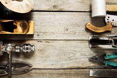 Many working tools on a wooden background Royalty Free Stock Images