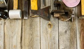 Many working tools on a wooden background Royalty Free Stock Photo