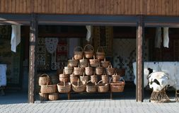 Basketry, woven baskets on a traditional trademarkt. Many woven baskets on a traditional trademarkt in Carpathian Mountains. In background homespun carpets, and stock photos