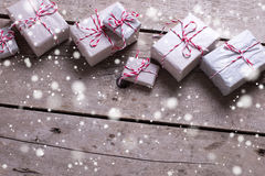 Many wrapped christmas presents  on aged wooden background. Stock Photography