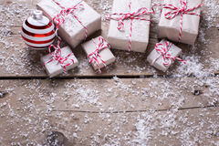Many wrapped christmas presents and decorative ball  on aged woo Stock Photos