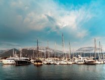 many yachts in the background of the mountains. Beautiful weather, incredible sky. stock images