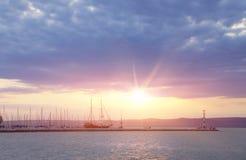 Many yachts and beautiful sunset Stock Photos