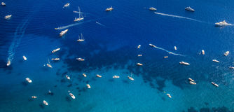 Many yachts and boats on the sea near Capri Island, Italy Royalty Free Stock Images