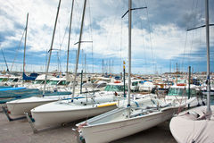 Many yachts docked in a bay of Blanes Stock Photo
