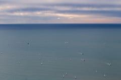 Many yachts at sea. Many yachts at black sea with evening sky royalty free stock images