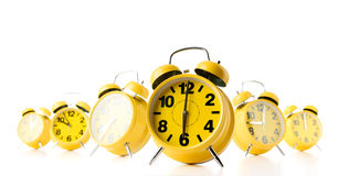 Many yellow alarm clock on white background. Stream of time concept Stock Photography