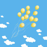 Many yellow balloons on a background of the blue s Stock Image