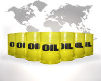 Many yellow barrels with oil on the world map background Royalty Free Stock Photo