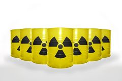 Many yellow barrels with sign of radiation on the white background Royalty Free Stock Photo