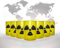 Many yellow barrels with sign of radiation on the world map background Stock Photo
