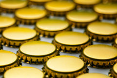 Many yellow bottle caps on white Royalty Free Stock Photos