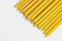 many yellow church candles on white background royalty free stock photo