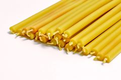 many yellow church candles on white background stock images