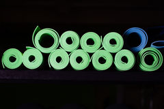 Many yoga mats green and blue colors Stock Images