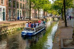 Many young students on a canal boat in a canal in Delft, the Netherlan royalty free stock image