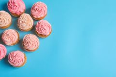 Many yummy cupcakes. On color background Stock Photography
