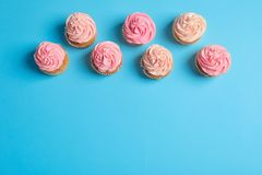 Many yummy cupcakes. On color background Royalty Free Stock Images
