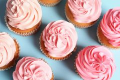 Many yummy cupcakes. On color background Royalty Free Stock Photo