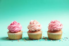 Many yummy cupcakes. On color background Royalty Free Stock Photography