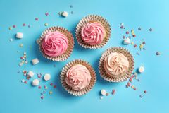Many yummy cupcakes. On color background Stock Image