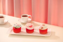 Many yummy cupcakes. Valentine sweet love cupcake on table on light background.  stock photos