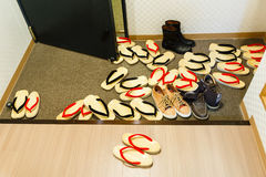 Many Zori sandal,a boot and sneakers. Royalty Free Stock Photo