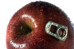 Manzana apetitosa con el abrelatas Imagenes de archivo