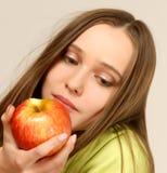 Manzana de la muchacha Imagen de archivo libre de regalías