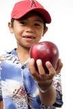 Manzana de ofrecimiento del niño Imagenes de archivo