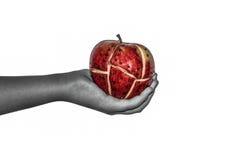 Manzana de Steampunk en la mano de las mujeres Imagen de archivo libre de regalías
