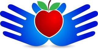 Manzana del corazón de la mano Imágenes de archivo libres de regalías