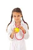 Manzana futura del chequeo de la muchacha del doctor Foto de archivo libre de regalías