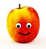 Manzana madura con la cara sonriente Imagenes de archivo