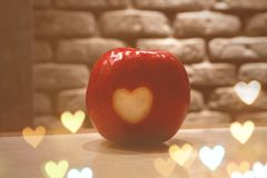Red Apple with hearts royalty free stock photography