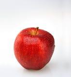 Manzana roja con gotas del agua Fotografía de archivo