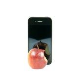 Manzana roja con la falta de una mordedura y de un teléfono elegante aislados en blanco Fotografía de archivo libre de regalías