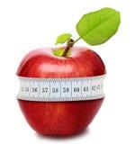 Manzana roja con la medida Foto de archivo