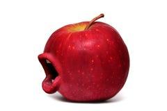 Manzana roja con una boca Imagen de archivo