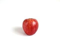 Manzana roja en el fondo blanco Foto de archivo libre de regalías