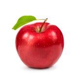 Manzana roja madura con la hoja verde Imágenes de archivo libres de regalías