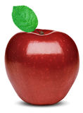Manzana roja madura con una hoja verde Imagenes de archivo