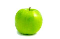 Manzana verde, aislada en el fondo blanco Foto de archivo