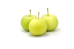 Manzana verde aislada en un fondo blanco Fotos de archivo